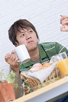 Young man holding a cup