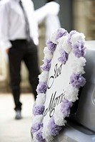 Just married sign, man standing in background