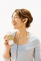 Woman Listening to Music over Coffee