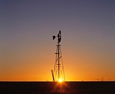 Silhouette of windmill, sunset