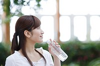 Woman Drinking Bottle Water