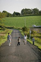 A family walking on the country road