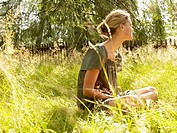 Woman sitting in the grass relaxing