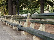 Row of empty park benches