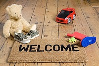 A welcome mat and toys
