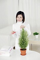 Woman trimming her plant