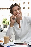 Man at cafe with cell phone