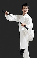 Man with nunchaku striking a pose for the camera