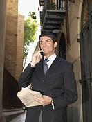 Smiling businessman talking on cellular phone