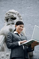 Businesswoman holding a laptop computer