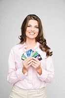 Portrait of young woman holding multiple credit cards