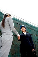 Businesswomen shaking hands at construction site