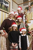 Portrait of family wearing Santa Claus hats