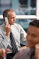 Serious businessman on cell phone