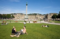 Tourists relaxing in lawn in front of building, Stuttgart, Baden_Wurttemberg, Germany