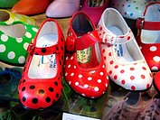 Flamenca shoes for girls in a shop window. Sevilla. Andalucia. Spain