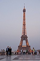 Tourists in front of tower, Eiffel Tower, Paris, France