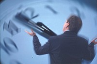 Rear view of businessman in front of giant clock