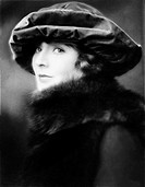 Portrait of a young woman wearing a hat and a fur stole All persons depicted are not longer living and no estate exists Supplier warranties that there...