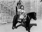 Cowgirl on pony All persons depicted are not longer living and no estate exists Supplier warranties that there will be no model release issues