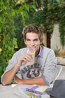 Man drinking soft beverage