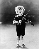 Portrait of little boy playing violin All persons depicted are not longer living and no estate exists Supplier warranties that there will be no model ...