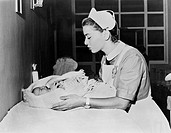 Nurse with crying baby All persons depicted are not longer living and no estate exists Supplier warranties that there will be no model release issues