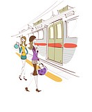 Two women walking at a subway platform