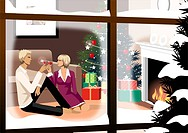 Couple toasting with glasses of red wine near a Christmas tree