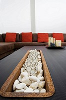 Decorative glasses and pebbles on a coffee table