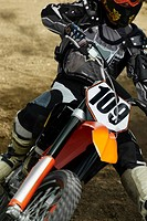 Close-up of a motocross rider riding a motorcycle