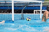 Water polo player in front of a goal post in a swimming pool (thumbnail)