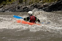 Rear view of a person kayaking in a river (thumbnail)