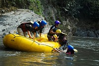 Side profile of three people pulling their friends on the raft