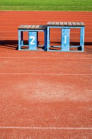 Winners podium on a running track (thumbnail)