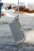 Rope tightened on a concrete block