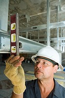 Close-up of a male construction worker using a spirit level