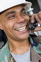 Close-up of a mature man talking on a mobile phone and smiling