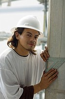Portrait of a male construction worker using a set square