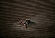 Plowing farm field, aerial