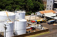 High angle view of storage tanks at an oil refinery, Nawiliwili Beach Park, Kauai, Hawaii Islands, USA