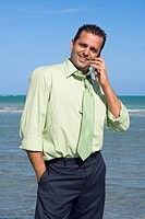Mid adult man talking on a mobile phone and smiling