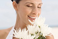 Close-up of a young woman smelling flowers