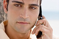 Close-up of a mid adult man using a mobile phone