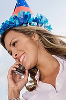 Low angle view of a young woman talking on a mobile phone and smiling