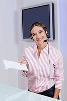 Portrait of a businesswoman holding documents and smiling