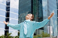 Businessman standing with his arms outstretched