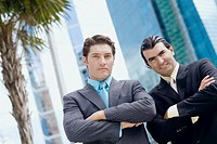 Portrait of two businessmen standing with their arms crossed