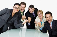 Portrait of five business executives cheering