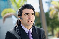 Businessman wearing a hands free device (thumbnail)